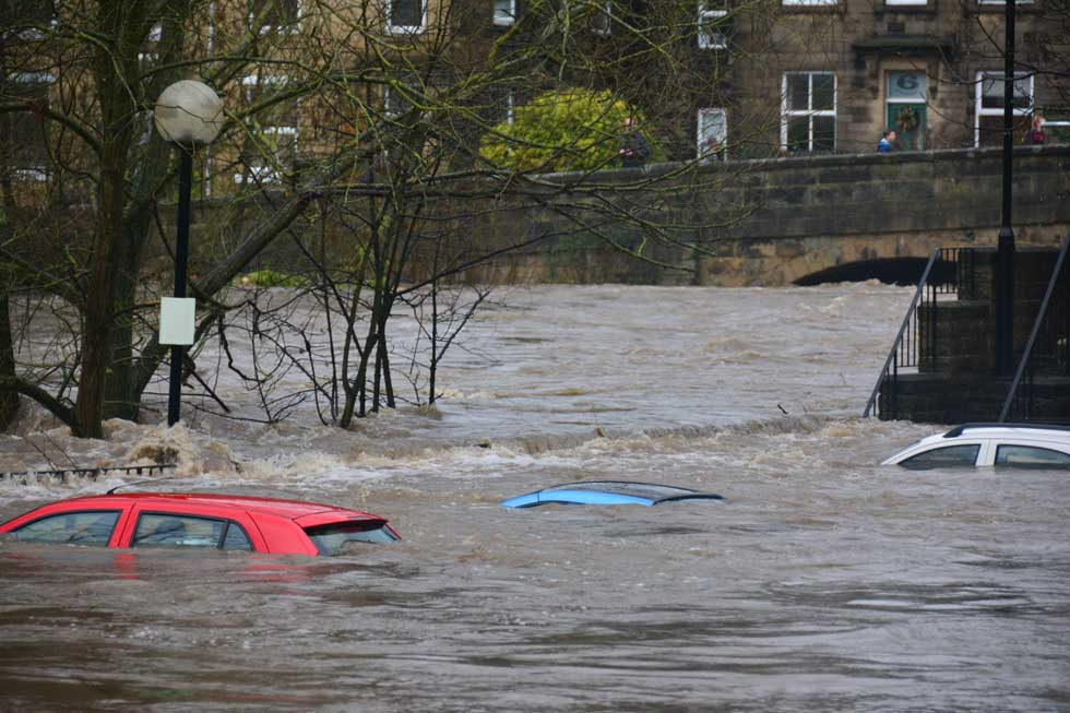 flooded river sunk cars